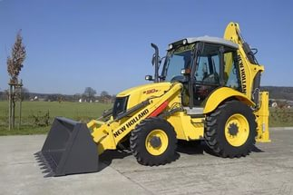 на фото: Экскаватор-погрузчик NEW HOLLAND B90B